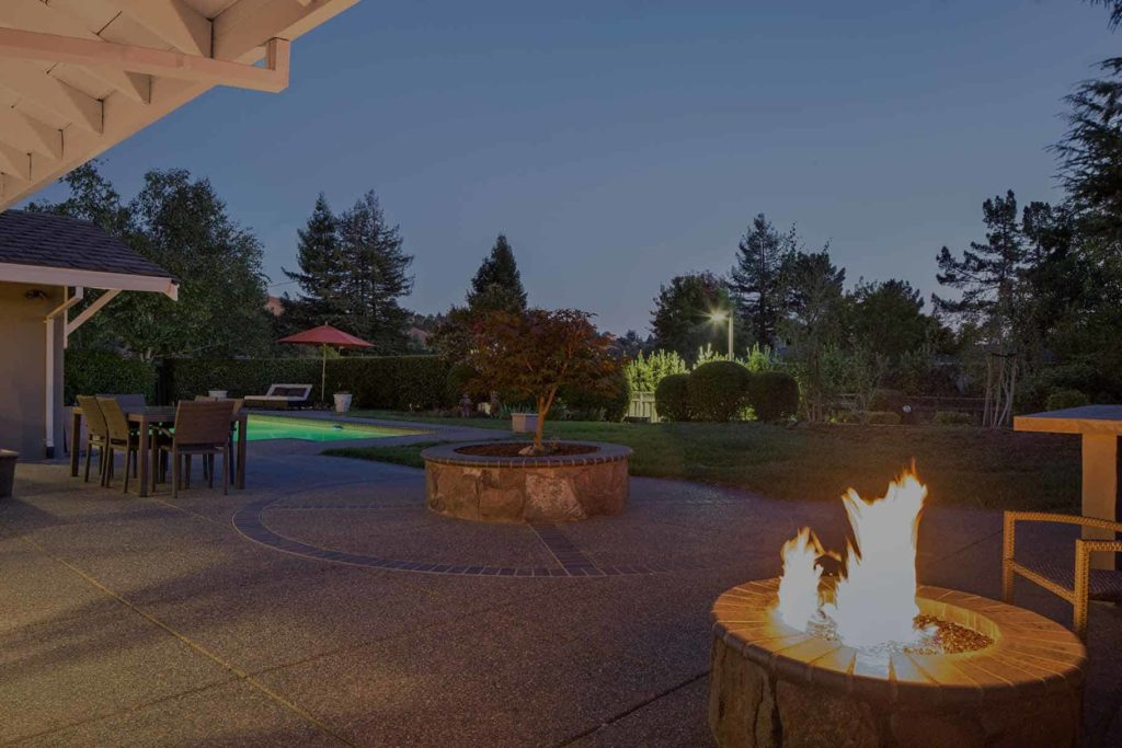 Amazing back yard with pool and fire pit.